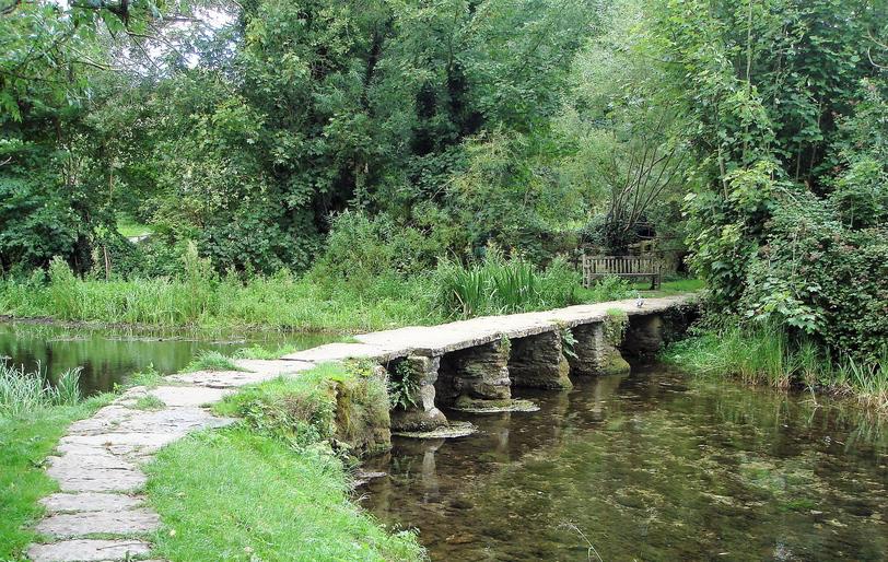 stone clapper bridge accross the River Leach in Eastleach
